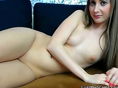 Webcam hottie plays with her shaved pussy