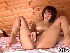 Horny oriental gets wet encircling sex tool