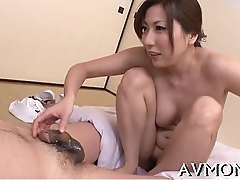 Beautiful asian babe licking cock