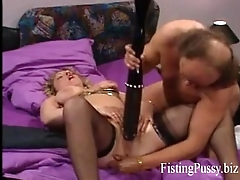 Hot brunette milf (FistingPussy.biz) gets a brutal fisting relative to the brush greedy pussy