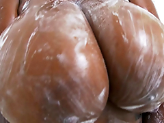 Rachel Raxxx gets her giant tits all soapy and wet