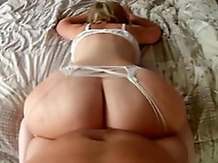 Mom lies on the bed shaking huge ass before sex in adored XXX positions